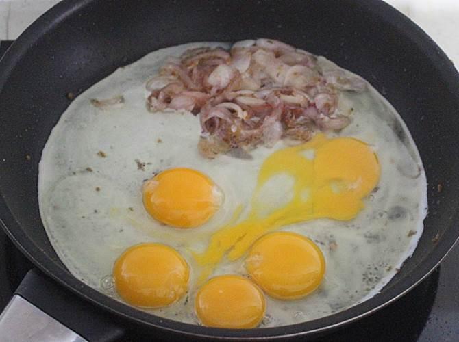 scrambling eggs in pan to make egg biryani recipe