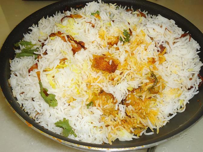 garnish potato biryani serve with raita