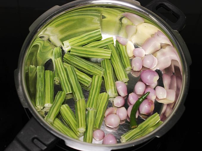 adding veggies to make drumstick sambar
