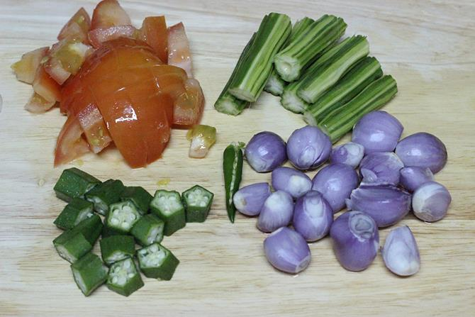 chopping mixed vegetables for making sambar recipe