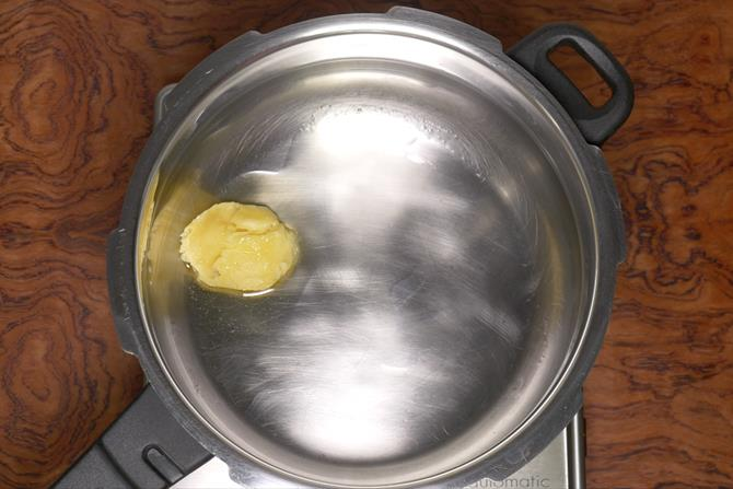ghee in a hot pot to make biryani
