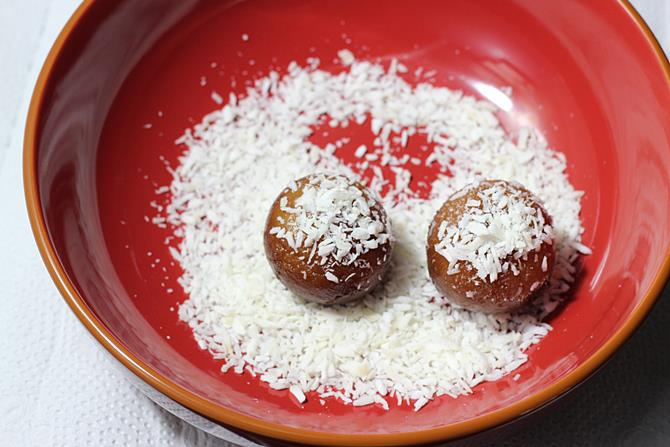 rolling balls in coconut to make dry gulab jamun