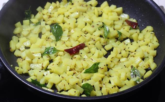 frying aloo on a low flame in potato fry recipe
