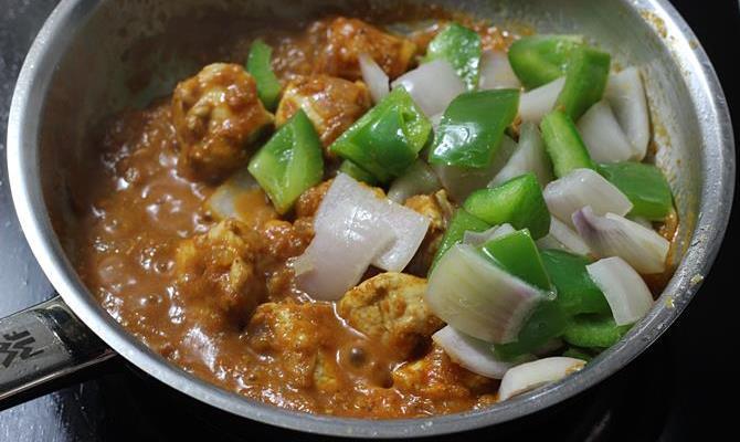 addition of fried onions capsicum to make chicken karahi recipe