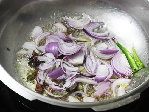 frying onions till golden to make chicken pulao recipe
