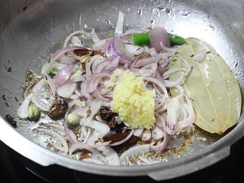 frying ginger garlic paste to make chicken pulao