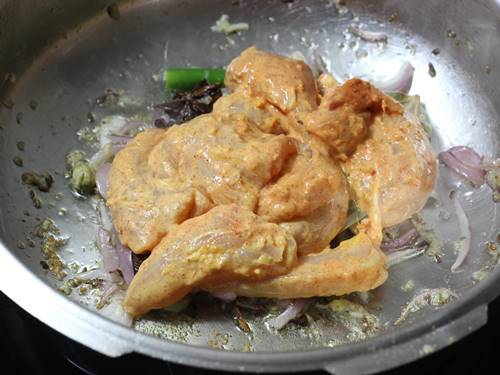 frying chicken to make pulao