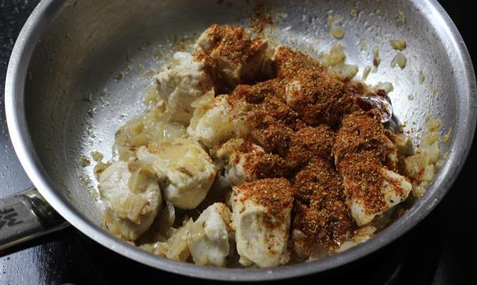 addition of garam masala to make kadai chicken recipe
