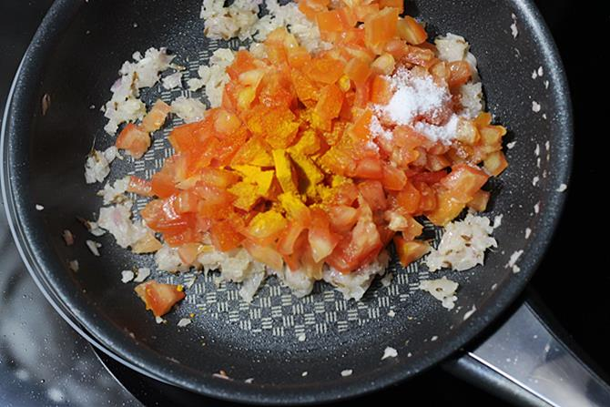 cooking tomatoes with salt turmeric to make mixed vegetable curry