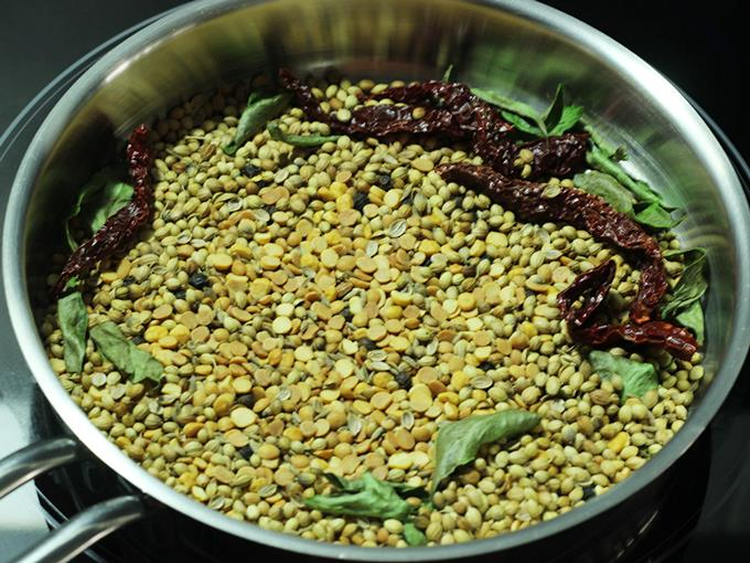 cooling roasted dals and spices to make rasam powder