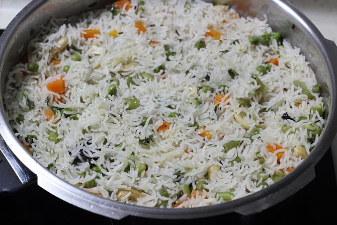 gently fluffing up the pulao