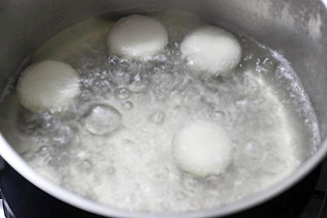 boiling discs in sugar syrup for rasmalai recipe