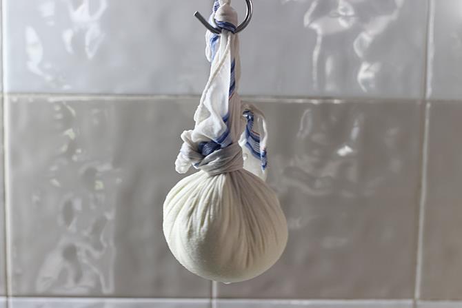 hanging paneer for draining in rasmalai recipe