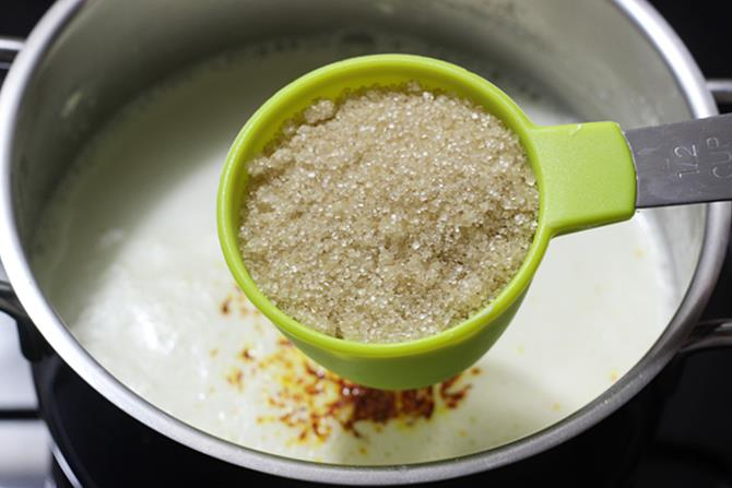 adding sugar for rabri in rasmalai recipe