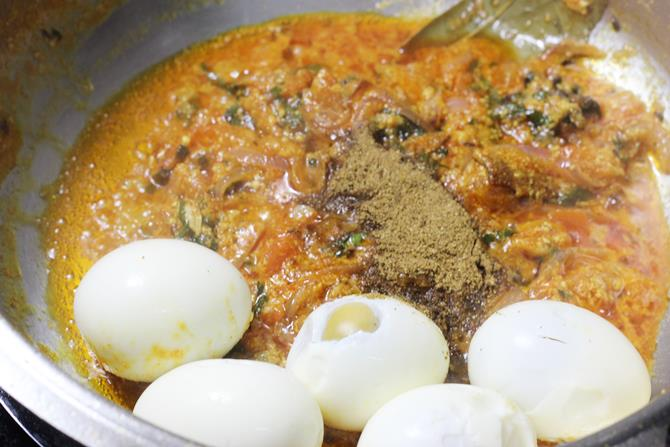 adding eggs to the pan to make egg biryani