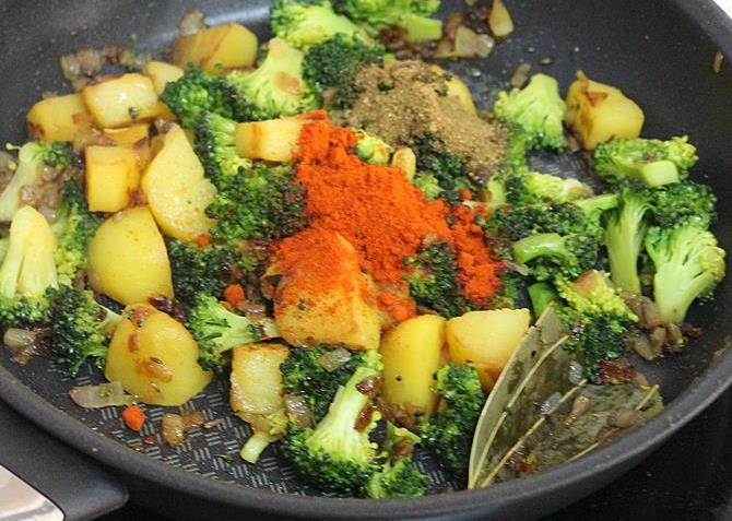 adding red chili powder masala to make broccoli gravy curry recipe