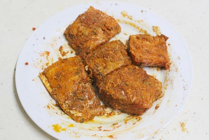 marinated fillet with spices to make amritsari fish fry