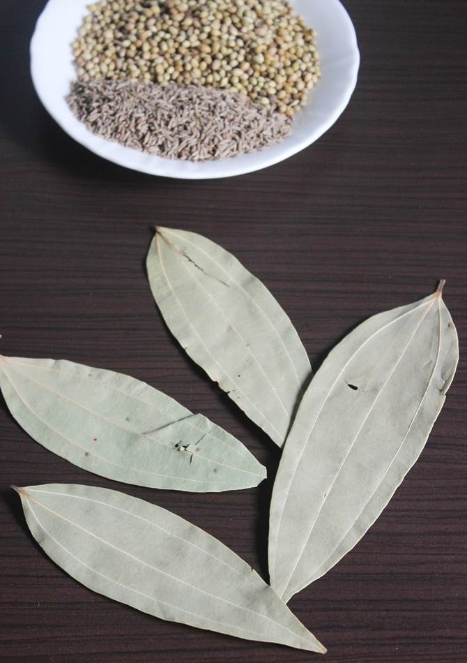 cleaning bay leaf to make garam masala powder recipe