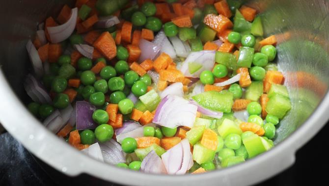 frying veggies for making khichdi recipe for toddlers