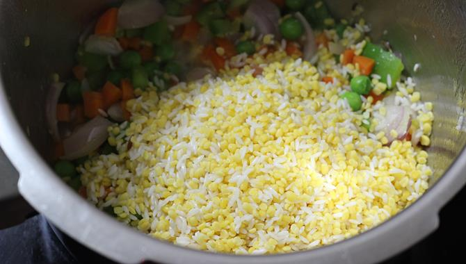 addition of dal to pan for khichdi recipe for toddler