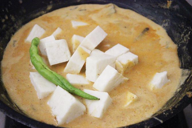 adding paneer in shahi paneer gravy