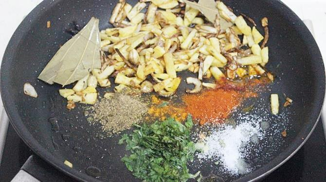 addition of spice powders for making indian potato rice recipe