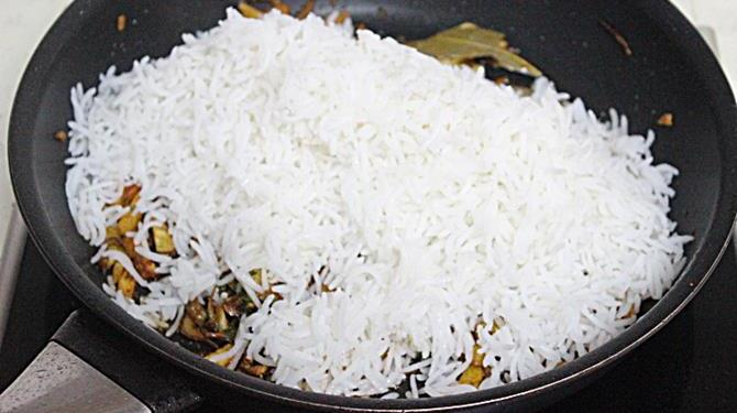 addition of rice to fry for potato rice recipe