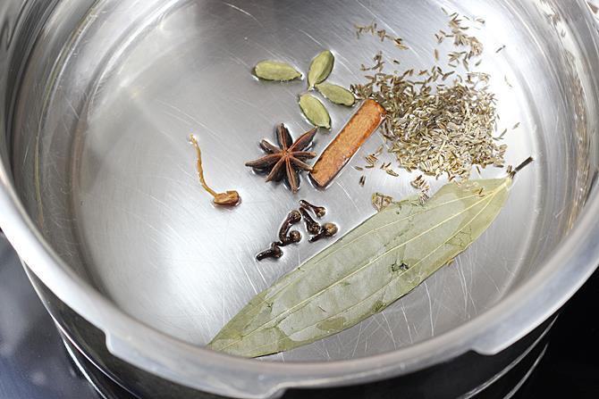 sautéing masala in oil for vegetable biryani in pressure cooker recipe
