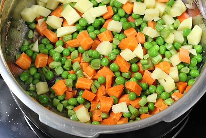 frying veggies for making easy vegetable biryani in pressure cooker recipe