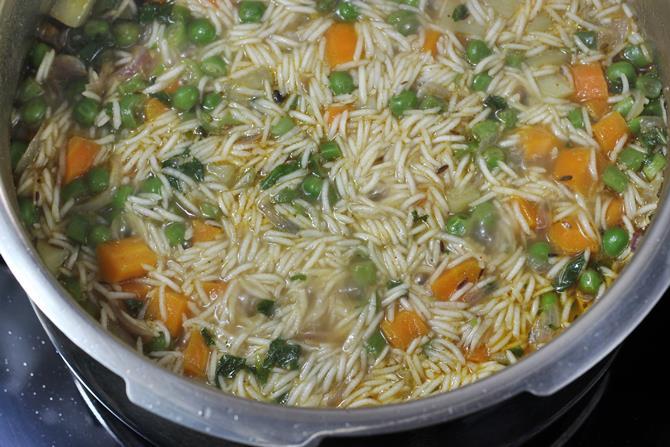 pressure cooking delicious vegetable biryani in pressure cooker recipe