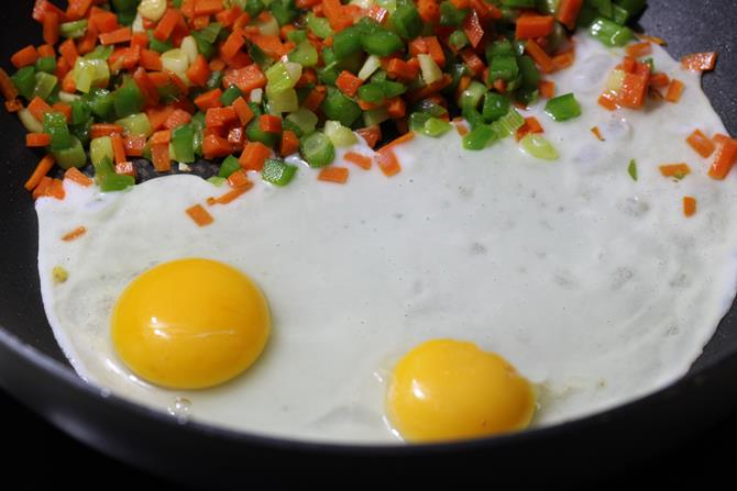 addition of eggs to pan