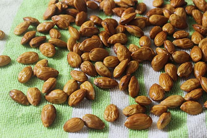 spreading them on cloth to blanch almonds