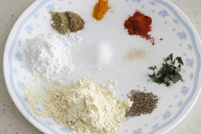 Add chickpea flour, rice flour, garam masala