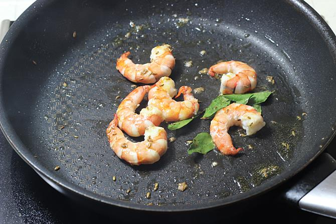 sauteing prawns for 2 minutes to prepare prawn curry recipe