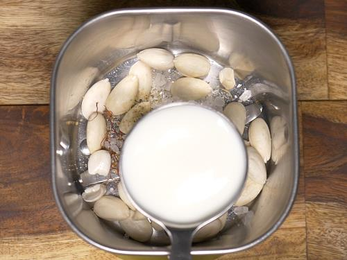 pouring milk to blender to make badam doodh