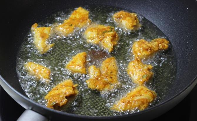 deep frying marinated meat in oil
