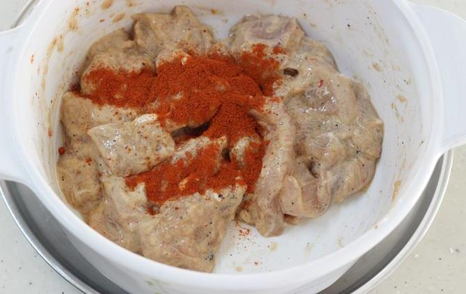 addition and mixing of chilli powder