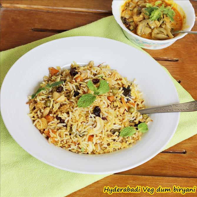 garnished hyderabadi veg biryani with mint and nuts by swasthi