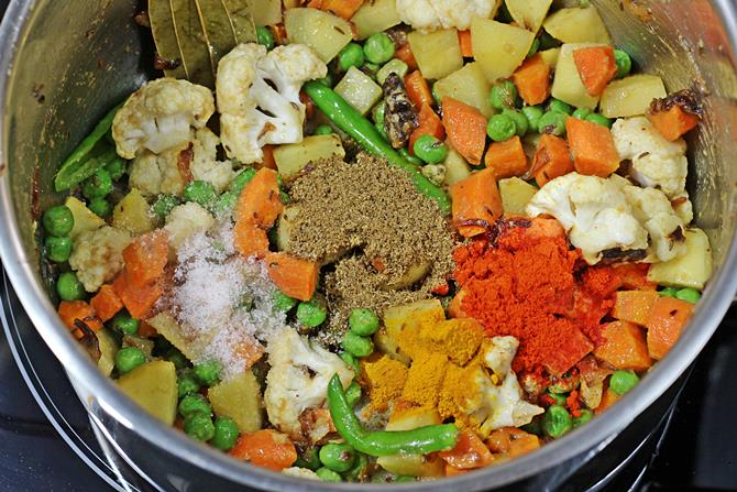 addition of spice powders for hyderabadi veg biryani recipe