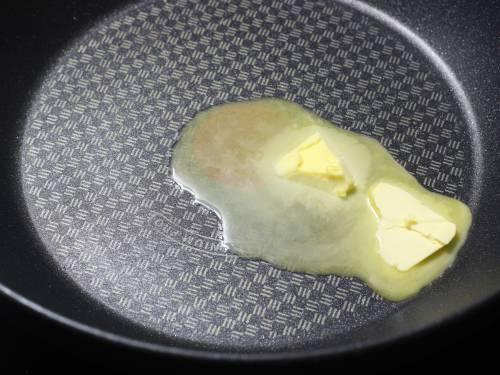 heating butter to make paneer butter masala