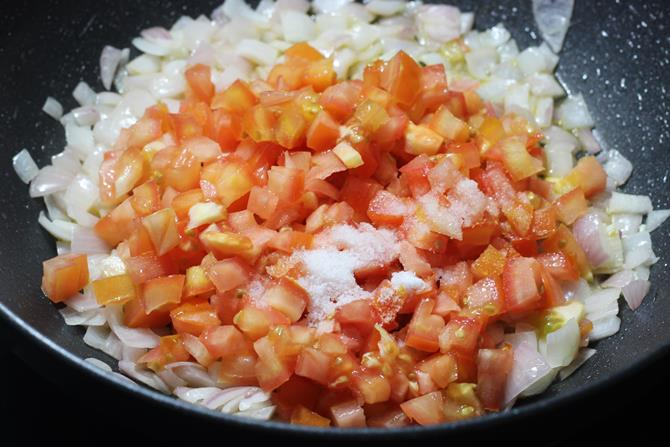 addition of tomatoes to make paneer butter masala recipe