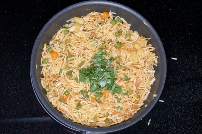 adding herbs to make tawa pulao