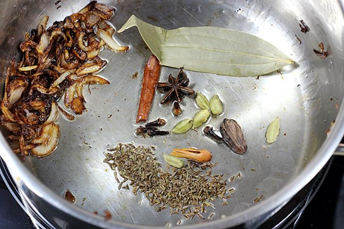 sauteing dry spices for aroma in veg biryani recipe