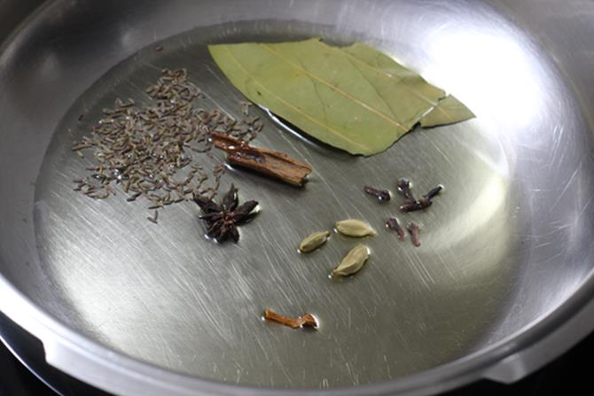 fry spices in oil