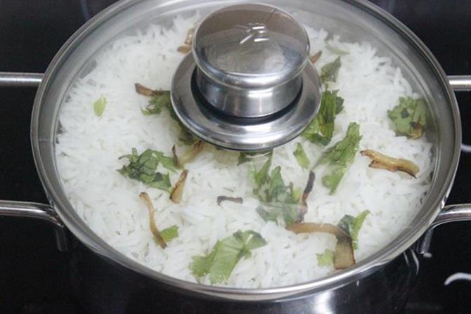 dum cook on a hot tawa to make mushroom biryani recipe