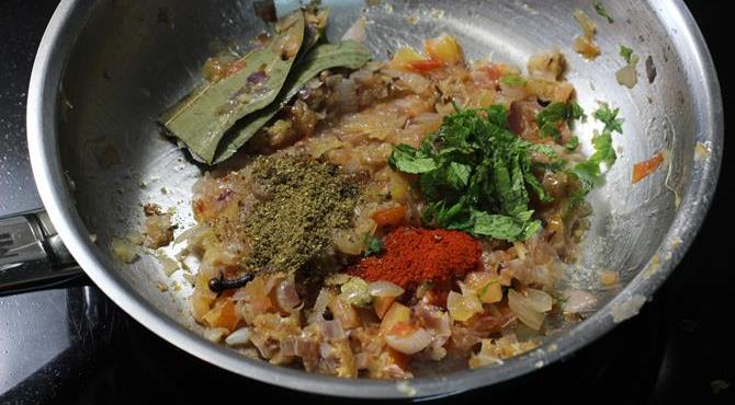 adding garam masala chili powder for making keema recipe