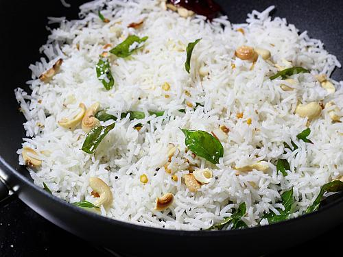 mixing coconut rice in the pan