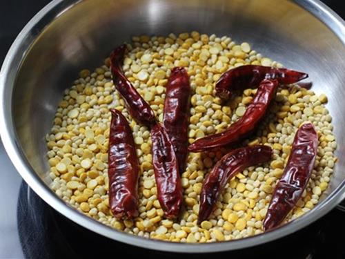 roasting dal chilies spices in pan for idli podi