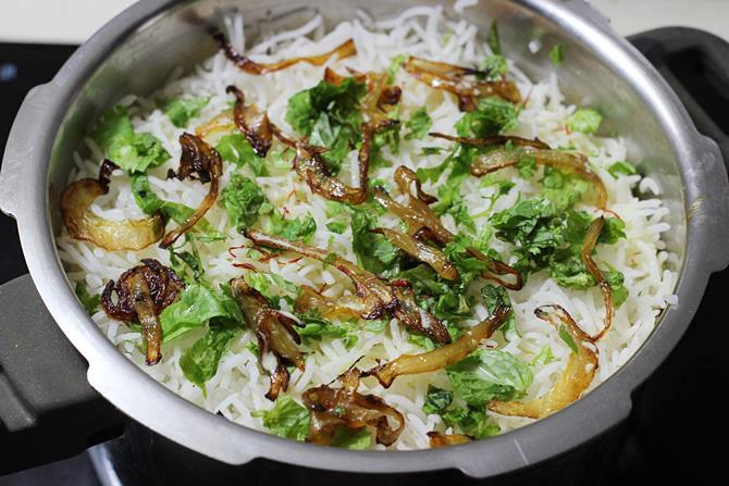 repeat layering cooked rice for fish biryani recipe