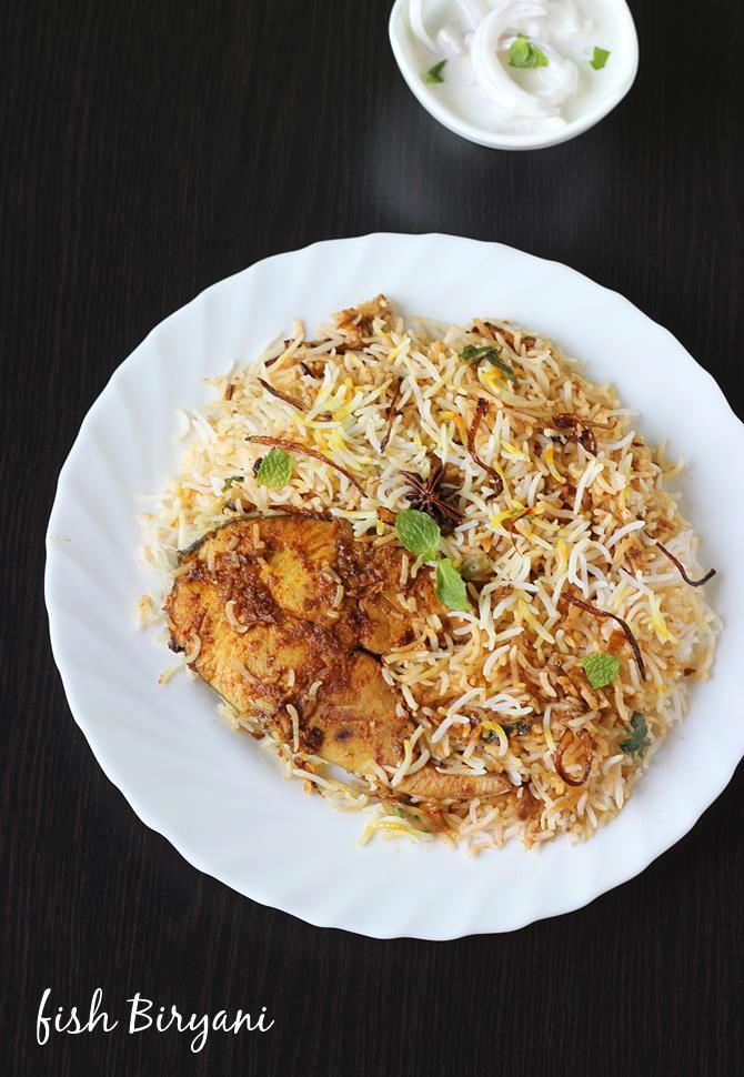 garnish with fried onions, coriander leaves to make fish biryani recipe